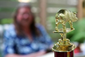 """""""Pecker,"""" standing atop the 8th-place trophy for ribs, shows off his huge family jewels at last weekend's """"Leftoverfest."""" Click on Claire's photo to appreciate the entire effect."""